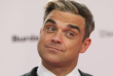Robbie Williams volvió a desnudarse, esta vez promociona un nuevo disco